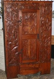Wardrobe, carved with 1 wooden door. 1900. Switzerland, 20th century..