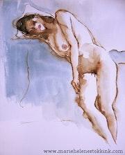 Femme nue en reposant sa tête.