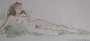 Femme nu avec coussin vert.
