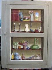 Cupboard door trompe l'oeil.