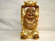 Gold statue. Michel Faure