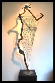 «The Web»… Steel, maple wood, dolls face and legs..