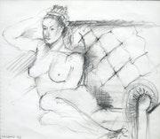 Woman naked on sofa.