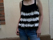 Tank top has fringe. Jetricote