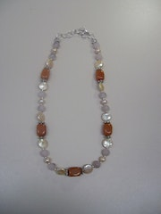 Necklace with genuine stones and pearl items.