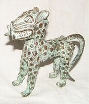 Loepard bronze animal totheme of his ethnic group. Carine Periet