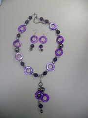 Shockin'purple, necklace in purple tones with charms and matching earrings .