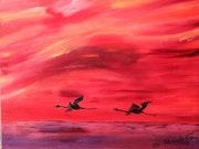 Flight of flamingos in the Camargue .