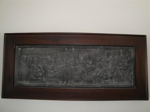 Balinese stone framed in wood frame. Rene Mueller Swissmagic