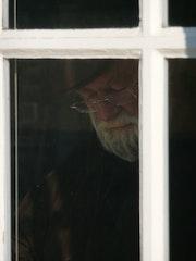 Behind the window X.
