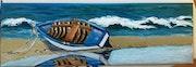 Barque sur le sable.