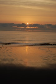 Dawn breaking over the North Sea at Scarborough. Aakschipper Images