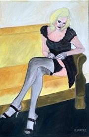 Jeune femme sur canape.