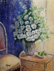 Vase with daisies in a room. Mary