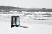 Beach chair alone standing by a strong breeze at the sea (Baltic Sea).