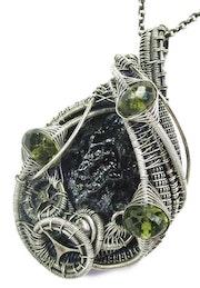 Black Tektite Wire-Wrapped Steampunk Pendant in Sterling Silver with Peridot. Heather Jordan Jewelry