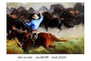 Vaquero con manada de caballos salvajes. Michele Fiore