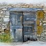 Abandon (portes de grange dans un village du Lot (France). Claude Evrard