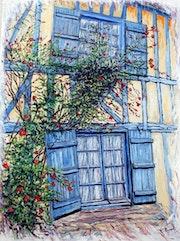 Le rosier sur la façade (Maison médiévale à Gerberoy).