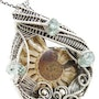 Ammonite Pendant with Aquamarine, Wire-Wrapped in Sterling Silver. Heather Jordan Jewelry