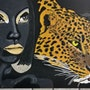 Leopard with woman painted on stretcher.