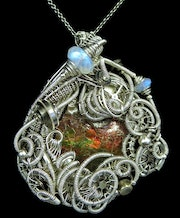 Ammolite Steampunk Pendant with Recycled Watch Parts and Rainbow Moonstone.