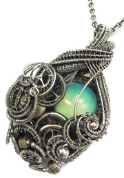 Color-Changing «Mood» Steampunk Pendant with Recycled Watch Parts.
