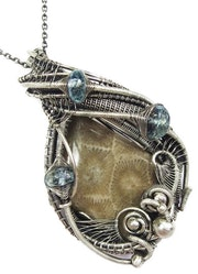 Wire-Wrapped Petoskey Stone Pendant with Blue Topaz.
