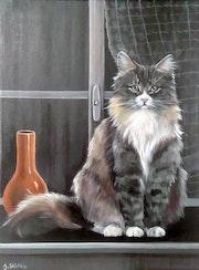 Le chat sur le rebord d'une fenêtre.