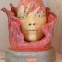 Masque de corail. Lionel Periault