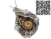 Fossilized Ammonite Wire-Wrapped Pendant with Aquamarine Nuggets.