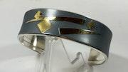 Bracelet manchette argent et or.