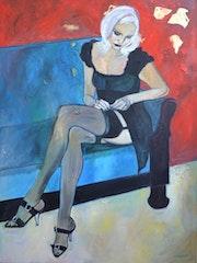 Femme dans canape turquoise. Nathalie Vareille Sorbac