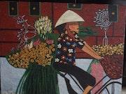 Vendedora de flores, vietnam.