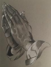 En prière.