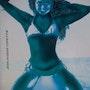 Jeune fille à genoux sur la plage. Jean-Jacques Copetta