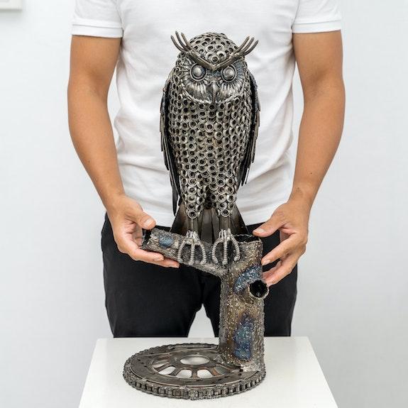 Owl with o ring metal sculpture.  Mari9Art