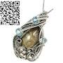 Petoskey Stone Wire-Wrapped Pendant with Blue Topaz. Heather Jordan Jewelry