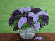 A vase of lilacs.