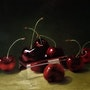 Cherries and silver box.