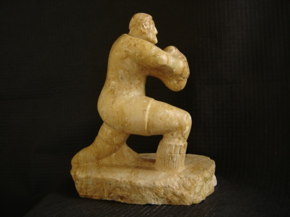 Limestone sculpture depicting a rugby player. Patrice Kauffmann Patrice Kauffmann