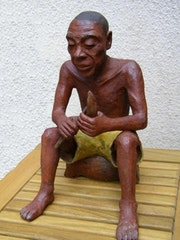 Patinated terracotta sculpture of a sculptor Africa.