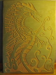 Dragon engraved on lime plaster. Mikael Turpin