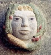 Child's face colored sandstone.
