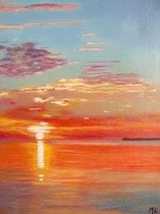 Die Sonne stieg über dem Meer.
