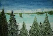 The frozen mountain lake in Ontario, Canada.