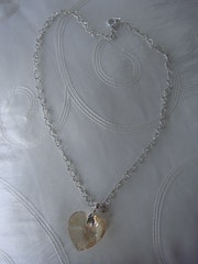 While hearts necklace with 925 Silver Heart Swarovski Golden Shadow.