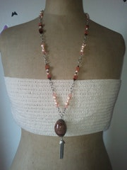 Saltire stone of Africa and coral beads. Agnes Bourgeron