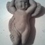 Terracota escultura de un ángel. Marie D