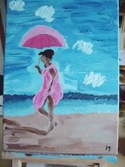 La jeune femme à la plage.